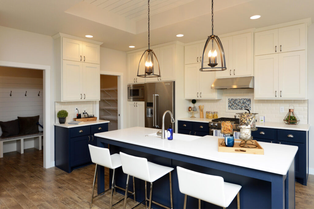 Superior This Kitchen In Our 2585 2 Story Model Home Incorporates The Custom Navy  Blue Base Cabinets With White Upper Cabinetry. Accent Pieces Include Nickel  Cabinet ...
